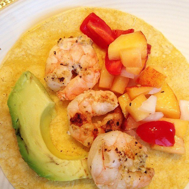 Dinner tonight... Shrimp tacos with peach salsa off the grill! Gotta grill when it's a beautiful day like today!
